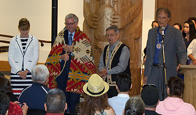 UBC President Stephen Toope is ceremoniously blanketed First Nations House of Learning, Photo by K. Ward