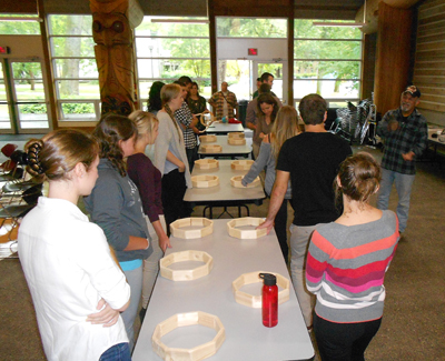 Medical students participate in a traditional drum making session led by Elder Old Hands.